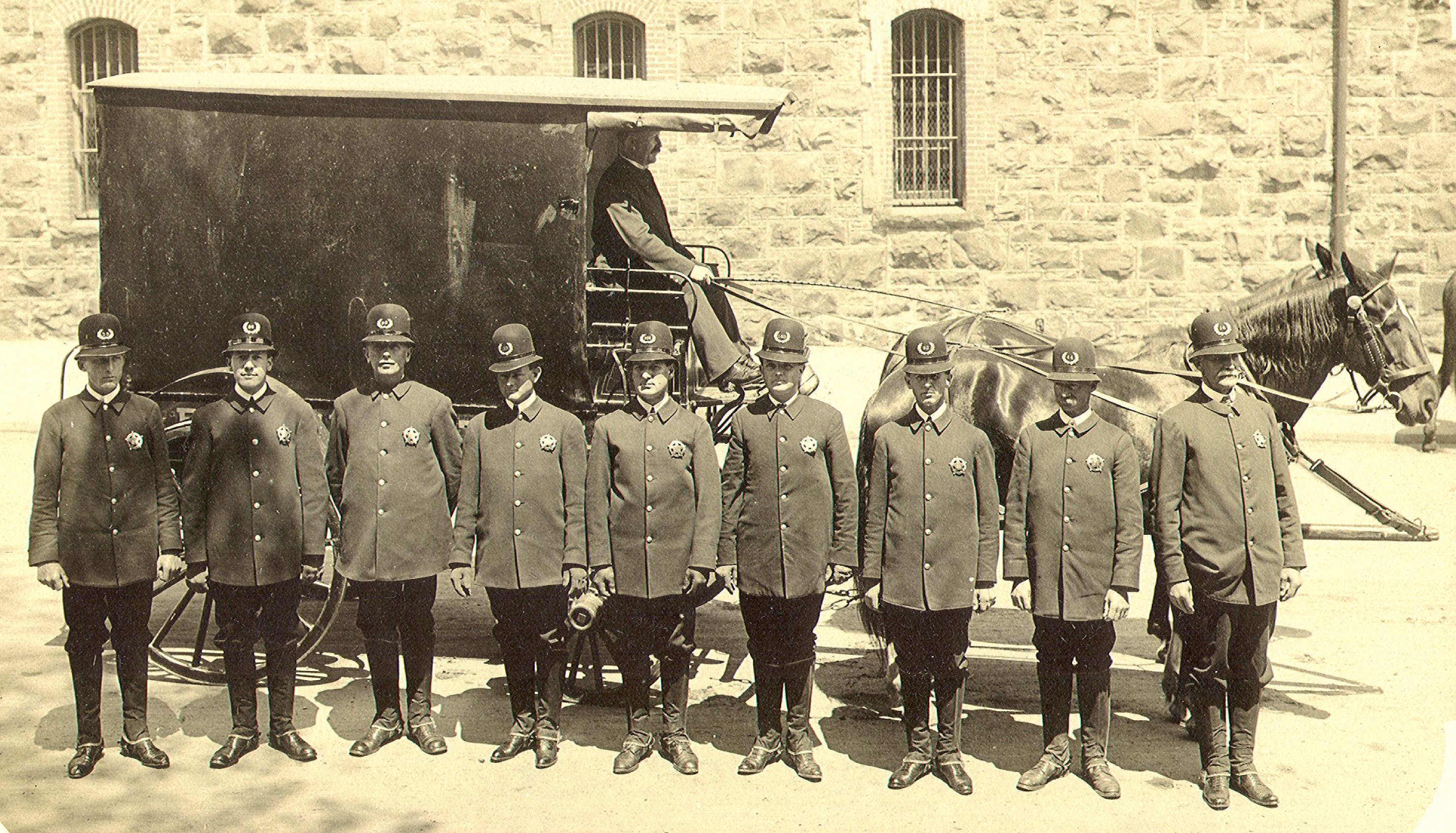1890s paddy wagon and officers, probably at the Armory